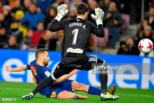 Barcelona's Spanish defender Jordi Alba scores against Celta Vigo's Spanish goalkeeper Sergio Alvarez during the Spanish Copa del Rey round of 16...