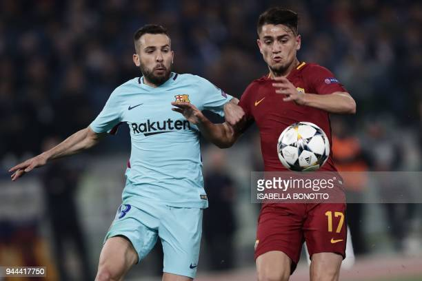 FC Barcelona's Spanish defender Jordi Alba vies for the ball with AS Roma's Turkish midfielder Cengiz Under during the UEFA Champions League...