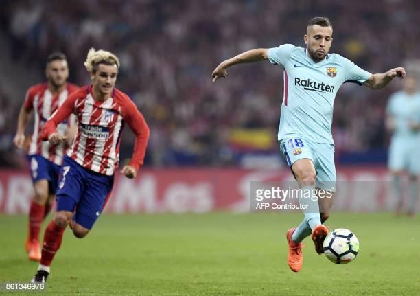 Barcelona's Spanish defender Jordi Alba vies with Atletico Madrid's French forward Antoine Griezmann during the Spanish league football match Club...
