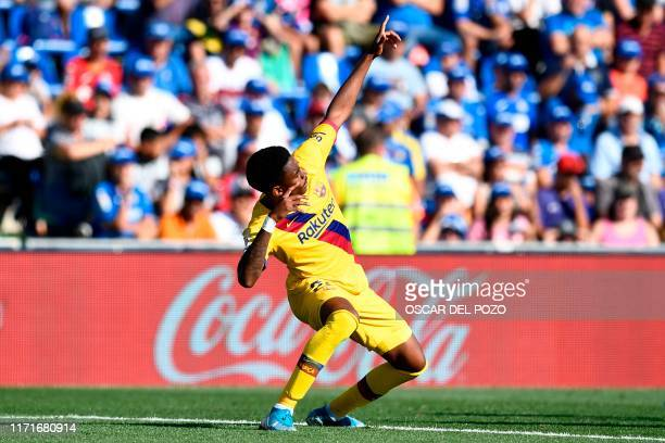 Barcelona's Spanish defender Junior Firpo celebrates after scoring a goal during the Spanish league football match between Getafe CF and FC Barcelona...