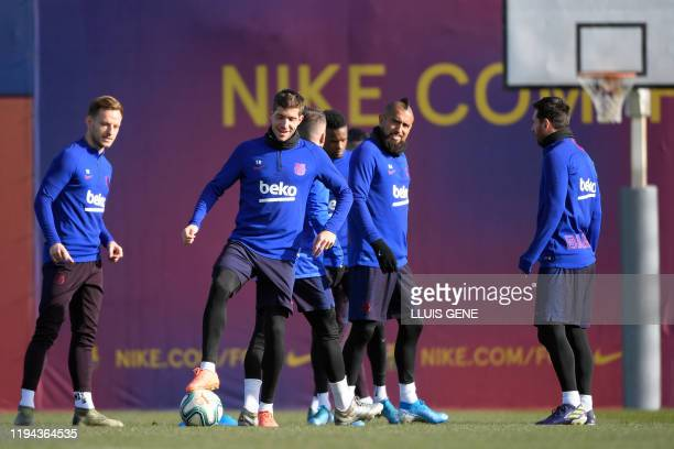 Barcelona's Spanish defender Sergi Roberto and teammates attend a training session at the Joan Gamper Sports City training ground in Sant Joan Despi...