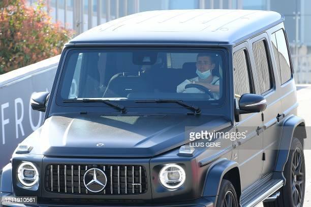 Barcelona's Spanish defender Sergi Roberto leaves after undergoing coronavirus tests at the Ciutat Esportiva Joan Gamper in Sant Joan Despi near...