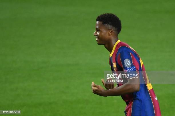 Barcelona's Spanish forward Ansu Fati celebrates after scoring a goal during the UEFA Champions League football match between FC Barcelona and...