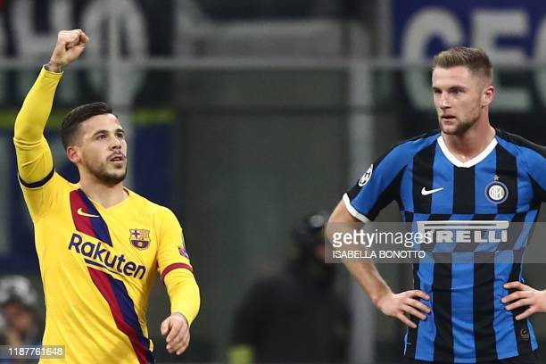 Barcelona's Spanish forward Carles Perez celebrates past Inter Milan's Slovakian defender Milan Skriniar after opening the scoring during the UEFA...