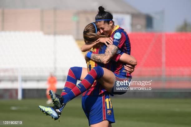 Barcelona's Spanish forward Jennifer Hermoso celebrates with Barcelona's Spanish midfielder Alexia Putellas after scoring a goal during the UEFA...