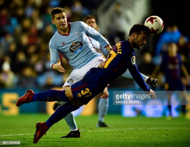 Barcelona's Spanish forward Jose Arnaiz heads the ball beside Celta Vigo's defender Andreu Fontas during the Spanish Copa del Rey football match RC...