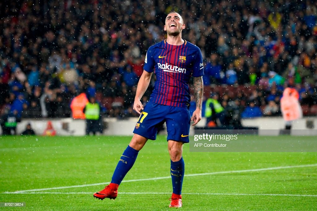 Barcelona's Spanish forward Paco Alcacer celebrates after scoring a goal during the Spanish league football match FC Barcelona vs Sevilla FC at the Camp Nou stadium in Barcelona on November 4, 2017. / AFP PHOTO / Josep LAGO