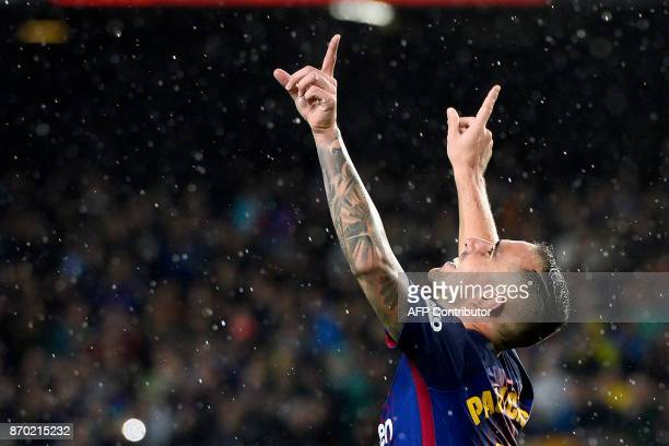 TOPSHOT Barcelona's Spanish forward Paco Alcacer celebrates after scoring a goal during the Spanish league football match FC Barcelona vs Sevilla FC...