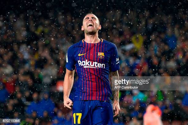 Barcelona's Spanish forward Paco Alcacer celebrates after scoring a goal during the Spanish league football match FC Barcelona vs Sevilla FC at the...