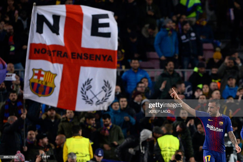 Barcelona's Spanish forward Paco Alcacer celebrates after scoring a goal during the UEFA Champions League football match FC Barcelona vs Sporting CP at the Camp Nou stadium in Barcelona on December 5, 2017. / AFP PHOTO / Josep LAGO