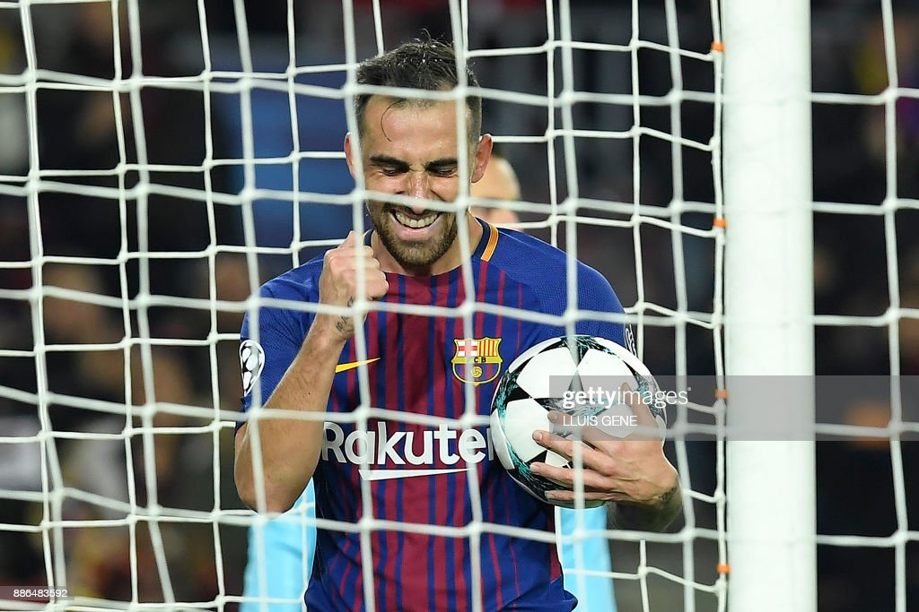 Barcelona's Spanish forward Paco Alcacer celebrates after scoring a second goal during the UEFA Champions League football match FC Barcelona vs Sporting CP at the Camp Nou stadium in Barcelona on December 5, 2017. /