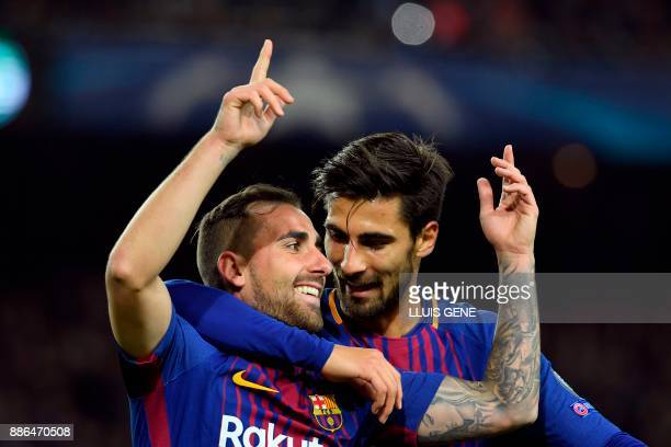 Barcelona's Spanish forward Paco Alcacer celebrates with Barcelona's Portuguese midfielder Andre Gomes after scoring a goal during the UEFA Champions...
