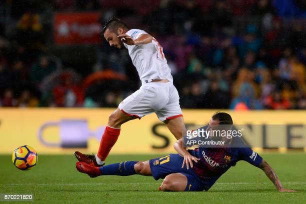 Barcelona's Spanish forward Paco Alcacer challenges Sevilla's Spanish midfielder Pablo Sarabia during the Spanish league football match FC Barcelona...