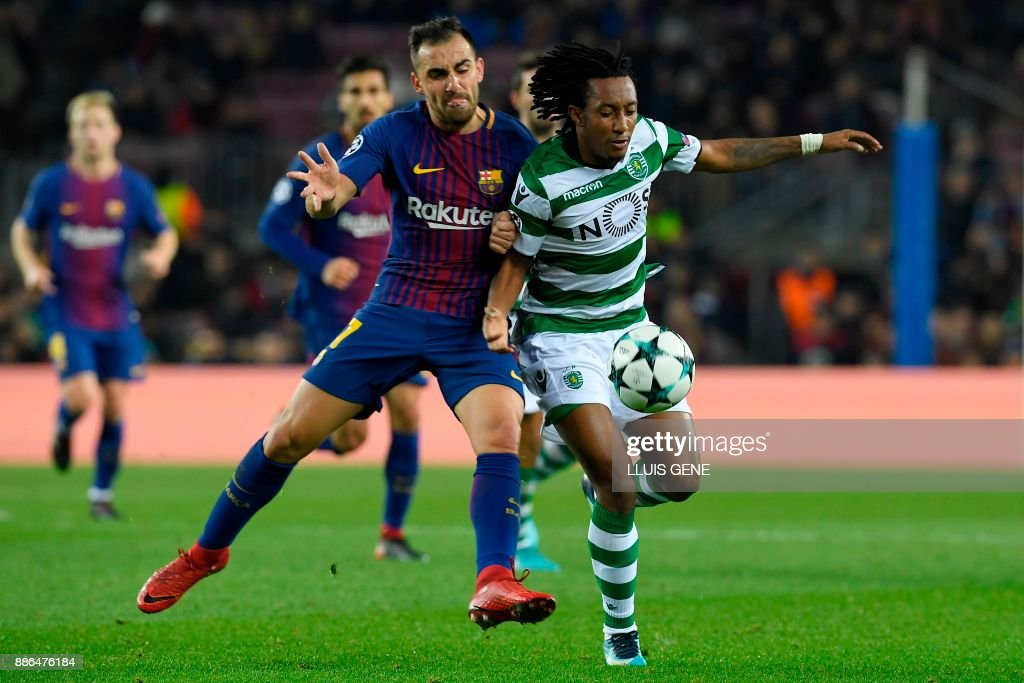 Barcelona's Spanish forward Paco Alcacer (L) challenges Sporting's Portuguese forward Gelson Martins during the UEFA Champions League football match FC Barcelona vs Sporting CP at the Camp Nou stadium in Barcelona on December 5, 2017. /