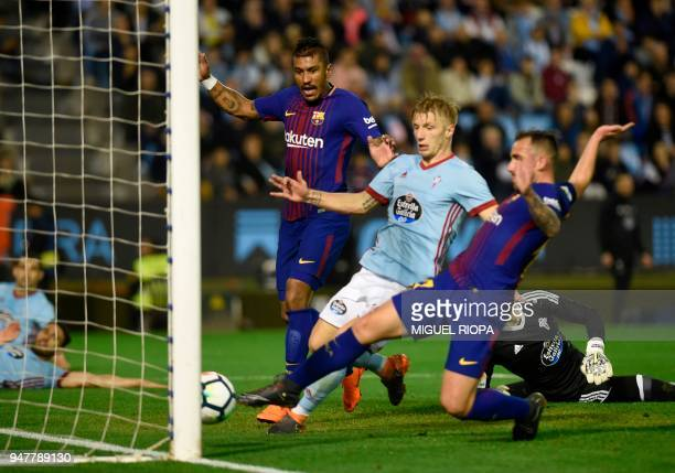 Barcelona's Spanish forward Paco Alcacer scores a goal beside Celta Vigo's Danish midfielder Daniel Wass and Barcelona's Brazilian midfielder...
