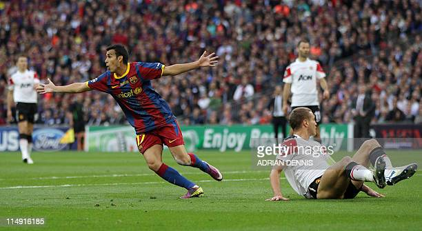 Barcelona's Spanish forward Pedro Rodriguez celebrates after scoring a goal during the UEFA Champions League final football match FC Barcelona vs...