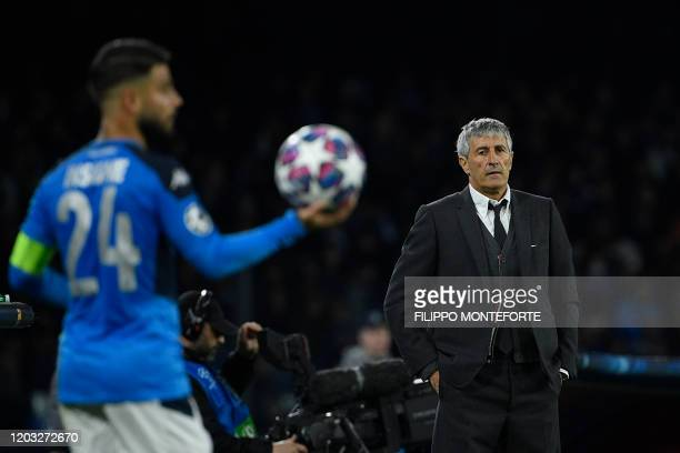 Barcelona's Spanish head coach Quique Setien looks on during the UEFA Champions League round of 16 firstleg football match between SSC Napoli and FC...