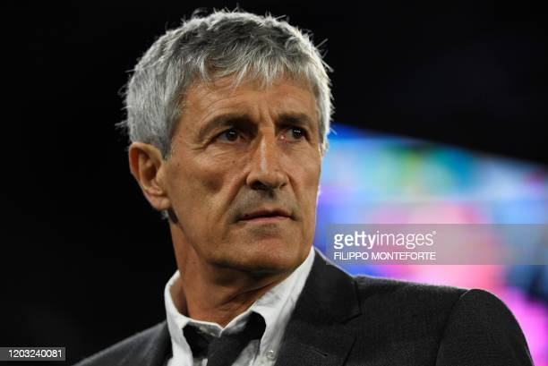 Barcelona's Spanish head coach Quique Setien looks on prior to the UEFA Champions League round of 16 firstleg football match between SSC Napoli and...