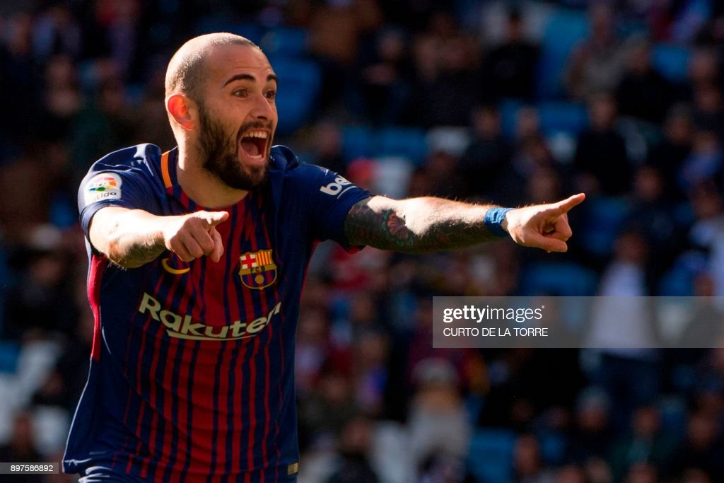 Barcelona's Spanish midfielder Aleix Vidal celebrates after scoring during the Spanish League 'Clasico' football match Real Madrid CF vs FC Barcelona at the Santiago Bernabeu stadium in Madrid on December 23, 2017. /