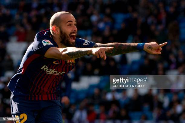 Barcelona's Spanish midfielder Aleix Vidal celebrates after scoring during the Spanish League 'Clasico' football match Real Madrid CF vs FC Barcelona...