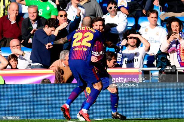 Barcelona's Spanish midfielder Aleix Vidal celebrates with Barcelona's Argentinian forward Lionel Messi after scoring during the Spanish League...