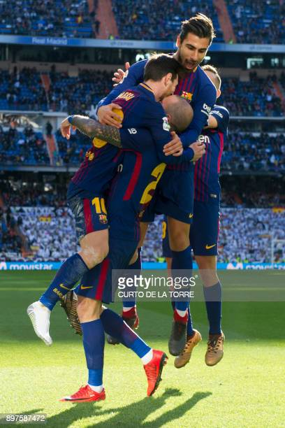 Barcelona's Spanish midfielder Aleix Vidal celebrates with teammtes after scoring during the Spanish League 'Clasico' football match Real Madrid CF...
