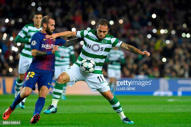 Barcelona's Spanish midfielder Aleix Vidal challenges Sporting's Brazilian midfielder Bruno Cesar during the UEFA Champions League football match FC...