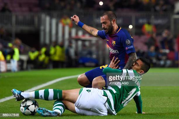 Barcelona's Spanish midfielder Aleix Vidal challenges Sporting's Argentinian forward Rodrigo Battaglia during the UEFA Champions League football...
