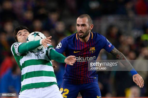 Barcelona's Spanish midfielder Aleix Vidal challenges Sporting's Argentinian forward Marcos Acuna during the UEFA Champions League football match FC...