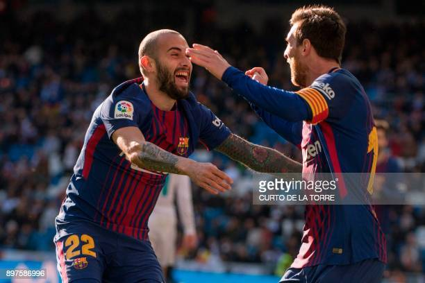 Barcelona's Spanish midfielder Aleix Vidal P celebrates with Barcelona's Argentinian forward Lionel Messi after scoring during the Spanish League...