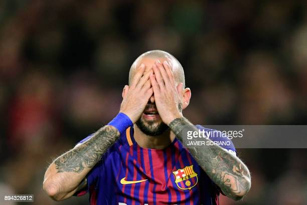 Barcelona's Spanish midfielder Aleix Vidal reacts after missing a goal opportunity during the Spanish league football match FC Barcelona against RC...