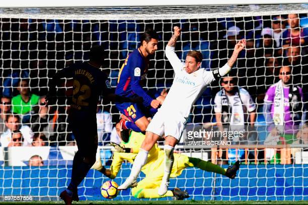 Barcelona's Spanish midfielder Aleix Vidal scored during the Spanish League 'Clasico' football match Real Madrid CF vs FC Barcelona at the Santiago...