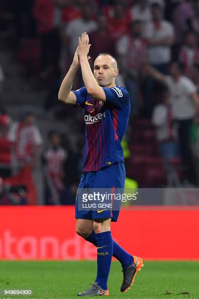 Barcelona's Spanish midfielder Andres Iniesta applauds as he leaves the field during the Spanish Copa del Rey final football match Sevilla FC against...