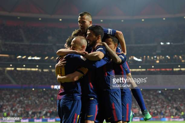 Barcelona's Spanish midfielder Andres Iniesta celebrates with teammates after scoring during the Spanish Copa del Rey final football match Sevilla FC...