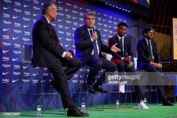 Barcelona's Spanish midfielder Ansu Fati addresses a press conference with President of FC Barcelona Joan Laporta , FC Barcelona's first vice...