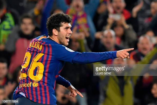 Barcelona's Spanish midfielder Carles Alena celebrates after scoring during the Spanish league football match FC Barcelona against Villarreal CF at...