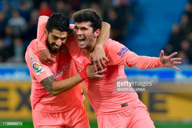 TOPSHOT Barcelona's Spanish midfielder Carles Alena celebrates with Barcelona's Uruguayan forward Luis Suarez after scoring a goal during the Spanish...