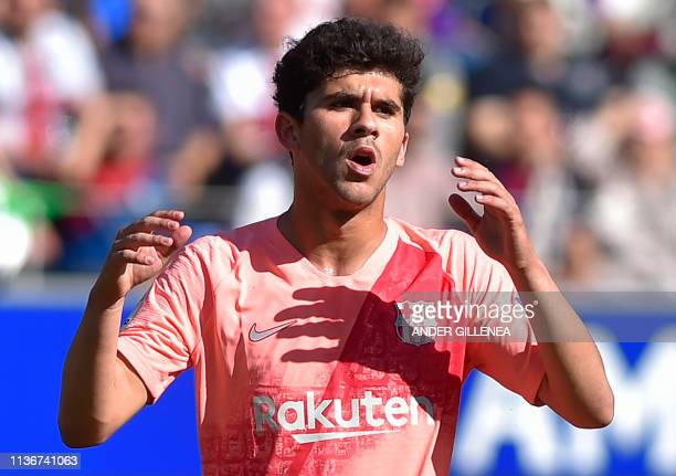 Barcelona's Spanish midfielder Carles Alena gestures during the Spanish league football match between SD Huesca and FC Barcelona at the El Alcoraz...