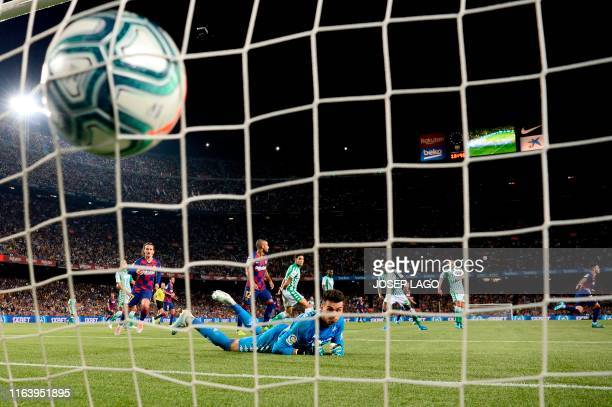 TOPSHOT Barcelona´s Spanish midfielder Carles Perez scores agaisnt Real Betis' Spanish goalkeeper Daniel Martin during the Spanish League football...