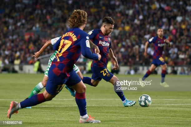 Barcelona´s Spanish midfielder Carles Perez scores during the Spanish League football match between Barcelona and Real Betis at the Camp Nou stadium...