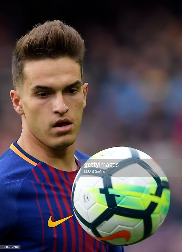 Barcelona's Spanish midfielder Denis Suarez eyes the ball during the Spanish league footbal match between FC Barcelona and Valencia CF at the Camp Nou stadium in Barcelona on April 14, 2018. /