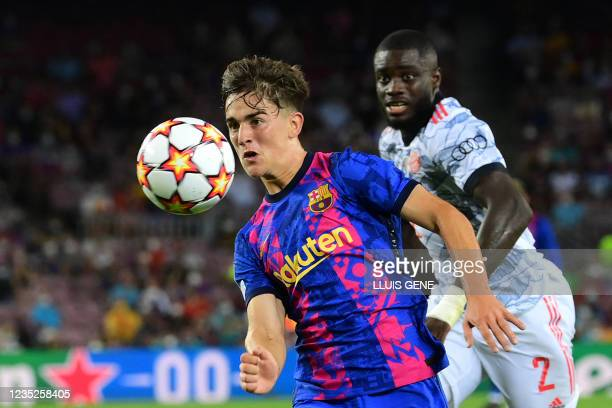 Barcelona's Spanish midfielder Gavi outpasses Bayern Munich's French defender Dayot Upamecano during the UEFA Champions League first round group E...