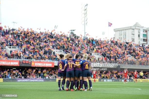 Barcelona's Spanish midfielder Mariona Caldentey celebrates her goal with teammates during the UEFA Women's Champions League semifinal second leg...