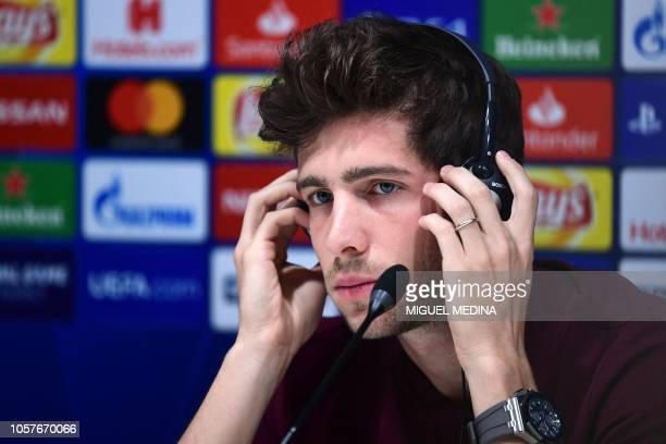 Barcelona's Spanish midfielder Sergi Roberto adjusts a translation headset during a press conference on November 5 2018 at San Siro stadium on the...
