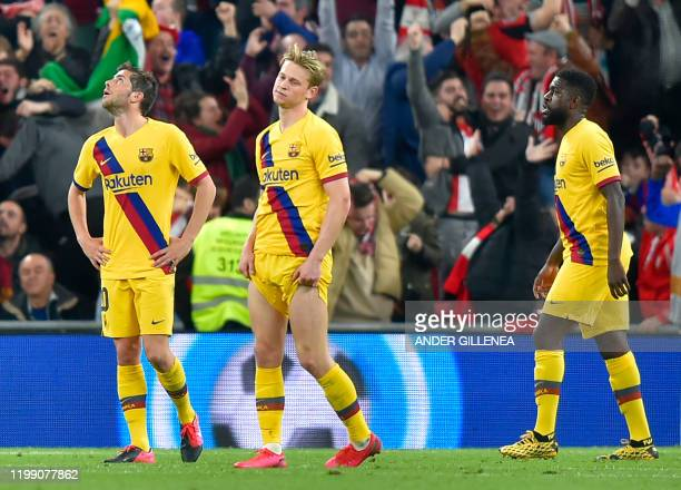 Barcelona's Spanish midfielder Sergi Roberto Barcelona's Dutch midfielder Frenkie de Jong and Barcelona's French defender Samuel Umtiti react to...