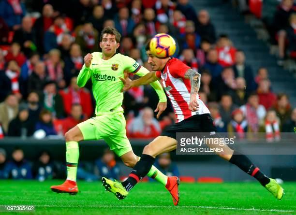 Barcelona's Spanish midfielder Sergi Roberto vies with Athletic Bilbao's Spanish defender Yuri Berchiche during the Spanish league football match...