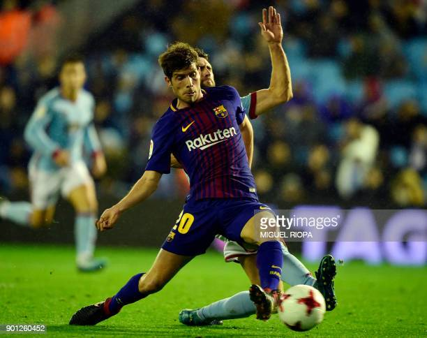 Barcelona's Spanish midfielder Sergi Roberto vies with Celta Vigo's defender Sergi Gomez during the Spanish Copa del Rey football match RC Celta de...