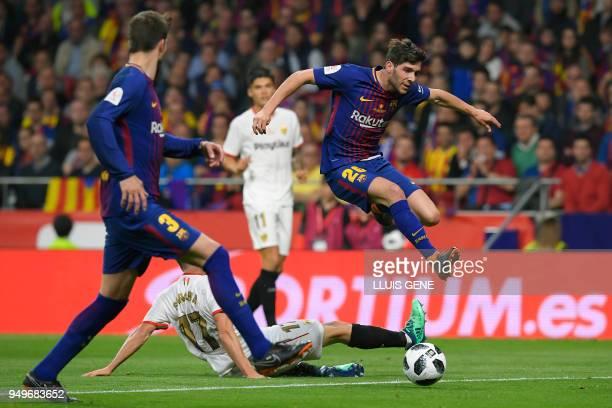 Barcelona's Spanish midfielder Sergi Roberto vies with Sevilla's Spanish midfielder Pablo Sarabia during the Spanish Copa del Rey final football...