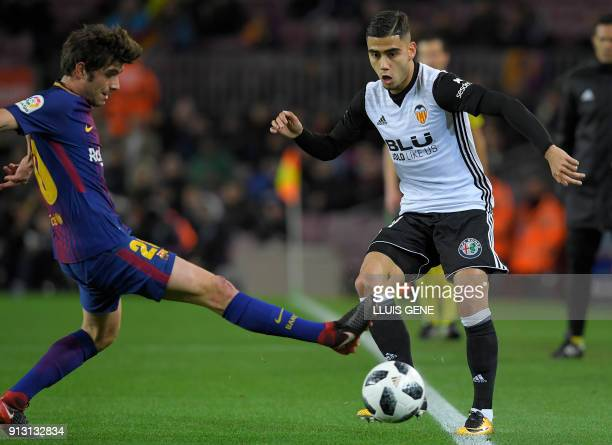 Barcelona's Spanish midfielder Sergi Roberto vies with Valencia's Brazilian forward Andreas Pereira during the Spanish 'Copa del Rey' first leg...
