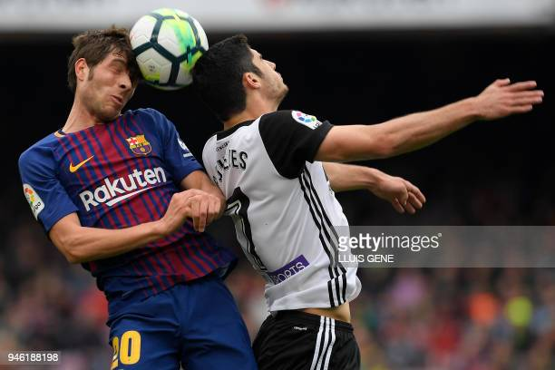 Barcelona's Spanish midfielder Sergi Roberto vies with Valencia's Portuguese forward Goncalo Guedes during the Spanish league footbal match between...